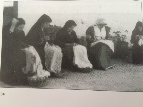 Greek ladies from the village bent over their Karsaniki needlework